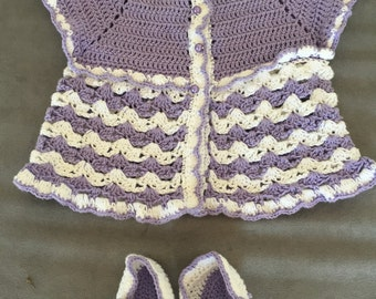 Very nice jacket with crochet purple/white with matching slippers. Size 3-6 months.