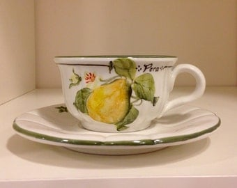 Hand painted ceramic coffee cup and saucer