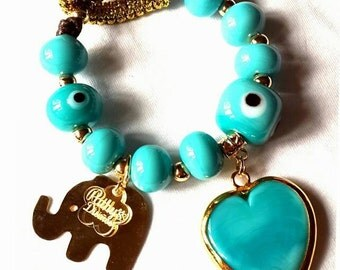 Turquoise handmade charm bracelet. Murano glass stone. One of a kind. Hand made stones and special design bracelet.