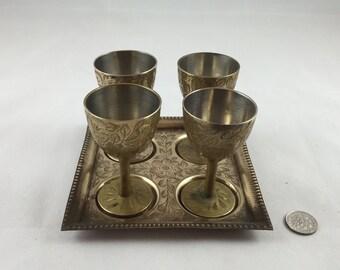 Four brass chalice wine glasses