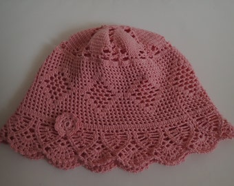 Handmade cute baby girl pink hat with a small  flower