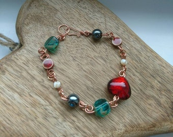 Twisted copper bracelet with red and greens
