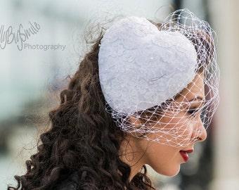 Heart shape bridal fascinator with birdcage veil