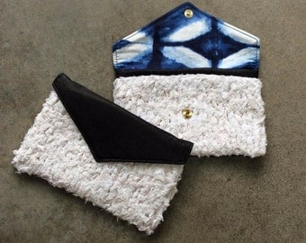White Knit and Black Clutch