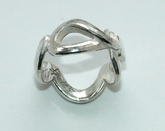 """Virgin"", 925, cast sterling silver ring."