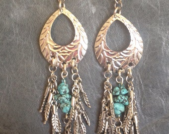 Silver tone earrings with turquoise and silver feather drops