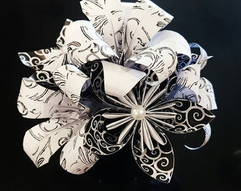 Black and white florigami flowers and lily's in a black pot with pearl centers