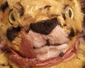 """Adorable vintage stuffed animal tiger, very well loved, cute expression, about 7"""" long, good condition"""