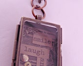 "Steampunk Oblong Brass Shadow Box Necklace Pendant Smile Laugh and Love with 18 "" Brass Chain and Do-Dads"