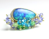 Boulder Opal Ring 18k Gold and Silver with Tanzanite, Apatite and Green Tourmaline.
