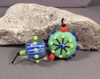 Handmade lampwork beads by Monaslampwork -Green Compas Focal and Striped Round- Handmade Lampwork Beads by Mona Sullivan Boho Organic Tribal