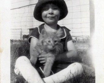 vintage photo 1915 Darling Girl in Flapper Hat Holds Cat in Grass
