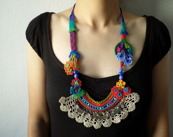 beaded crochet statement necklace - with orange, red, blue and green beaded flowers and cream crochet lace