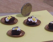 Plated baked potato miniature food