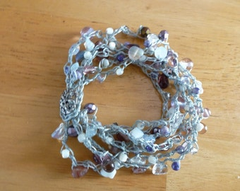 Lavender Haze Bead Crochet Bracelet has Numerous Beads in Shades of Lavender with Moonstone and Crystal