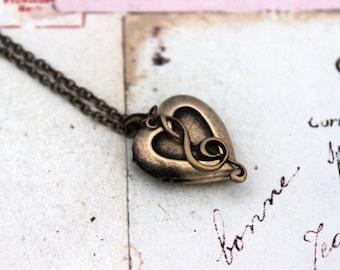 g clef. heart locket necklace. in brass ox jewelry
