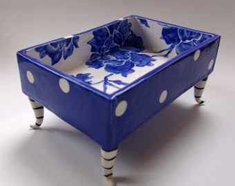 whimsical pottery Serving Dish delft blue hand painted floral with polka-dots, tall black & white stripe curly feet legs