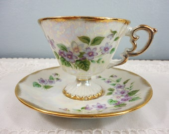 "Norleans ""Flower of the Month"" February Violet Lusterware Pedestal Teacup and Saucer"