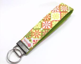 Keychain, key fob, key wristlet, key holder.  Bright floral square pattern.