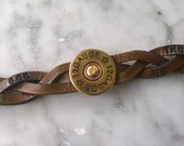 In God We Trust - Thin Braided Leather Wristband with Brass 12 gauge shotgun concho