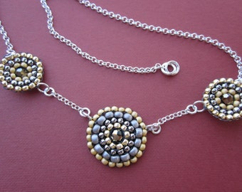 triple medallion focal necklace in mustard, pewter, gold and steel silver on sterling chain