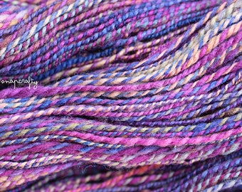 hand-spun striped yarn / 2-ply worsted weight / merino wool / waveform colorway / 178 yards / purple, violet, blue, lilac