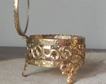 beautiful antique footed gold toned filigree jewelry casket features a hinged lid and glass top