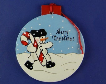 0039 Snowman with candy cane circle. Free shipping.  Message shown is a suggestion.  Can be written with a message/name/date of your choice