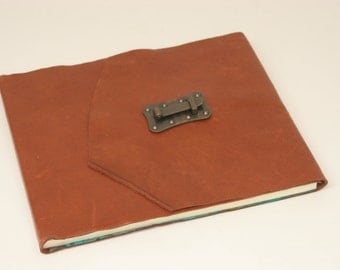 Gorgeous brown leather wedding guest book with lines for names, addresses, email and comments