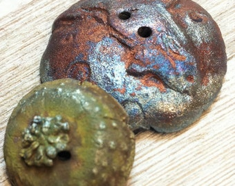 Two Raku Steampunk Whale Urchin Buttons Rust Silver Green The Pod is Arriving