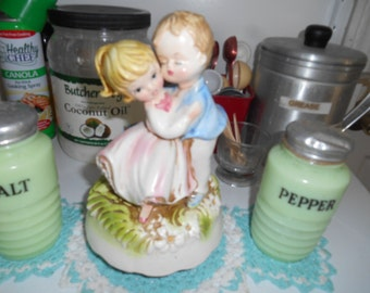 Lovely Porcelain boy holding girl wind up music box marked Japan Pat P turns around when wound up plays song
