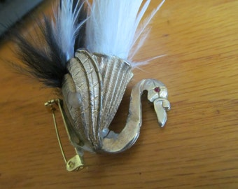 bird with feather brooch