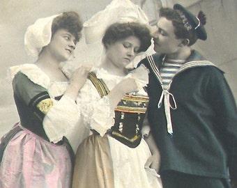 1900s French postcard, Sad lady & sailor, RPPC real photo postcard, paper ephemera.