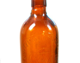 1900s Whiskey BOTTLE, Duffy Malt Whiskey, Rochester, New York.  Quack medicine, spirits.