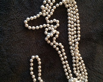 "Super long white plastic bead necklace.  45"""