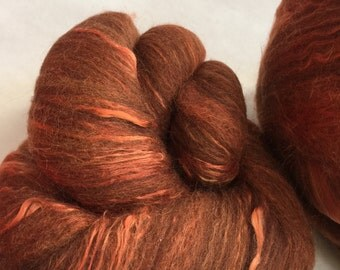 2 batts from a sheep called woolamena 50 percent corriedale 20 alpaca 20 mohair 10 silk 3.6oz ready for spinning.