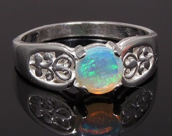 Natural Opal 1/2 carat Handset in .925 Sterling Ring  -  NOW on SALE  -  Fast Free Shipping.