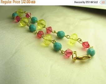Blue pink yellow bracelet ... beautiful glass beaded bracelet with gold links ... colorful carnival
