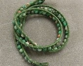 Triple wrap green agate bracelet with Adinkra African Button