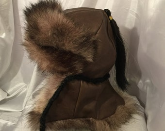 Mongolian, Russian, Norse Black timber wolf fur hat with ear flaps and fur down the back of the neck, brown leather top and black horse hair