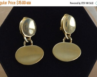 On sale Pretty Vintage Brushed, Polished Gold tone Clip Earrings