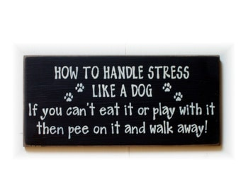 How to handle stress like a dog wood sign