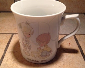 1984 Thumbuddy Cares Precious Moments Mug