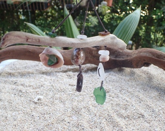 small wall hanging with Hawaii sea glass, sea shells and driftwood