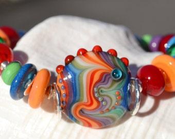 Reserve for Sandi-IMAGINE THAT-Handmade Lampwork and Sterling Silver Bracelet