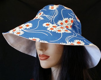 Cottage Hat Wide Brim Sun Hat in bright daisy print with adjust fit and reversible plus chinstrap for boating/convertibles/windy days