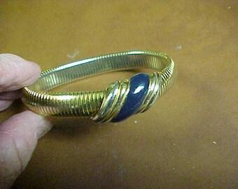Monet signed expansion bracelet with blue center