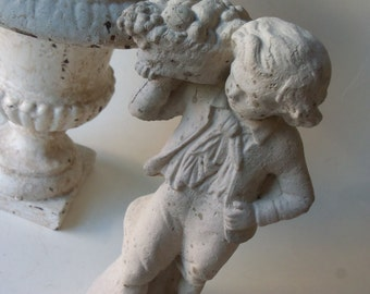 cement victorian boy with fruit basket