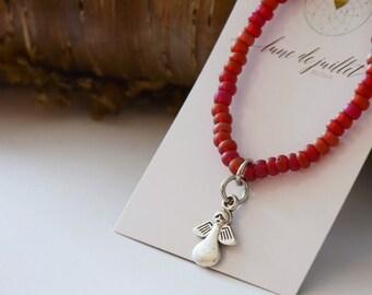 Bracelet rouge enfant petit ange