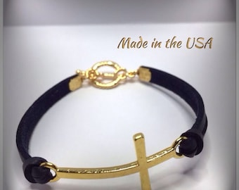 Gold and leather Sideways cross bracelet.